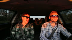 Men driving in the car, speaking, sunset Stock Footage