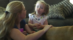 Mother and toddler playing and watching tv in their home Stock Footage