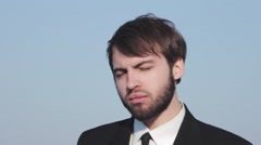 Young man businessman emotes. In the frame head, beard and shoulders Stock Footage