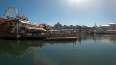 Locked down shot of V&A Waterfront in Cape Town with ferris wheel. Stock Footage