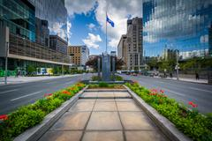 Gardens and memorial in the median of University Avenue, and modern buildings Stock Photos