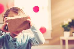 Toddler using a new virtual reality headset - stock photo