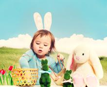 Toddler girl with Easter theme Stock Photos