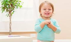 Happy toddler girl with a giant smile Stock Photos