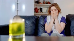 Sick girl coughs and looks at the medicine drug in cup of water Stock Footage