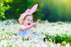 Little girl on Easter egg hunt Stock Photos