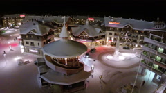 Flying over the winter resort village at night, Finland Stock Footage