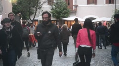Rome, Italy. Evening in Trastevere, people walk along narrow cozy streets Stock Footage
