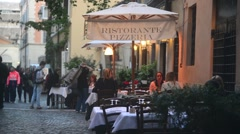 Rome Italy, modest cozy cafe on narrow street evening. Night life Trastevere Stock Footage