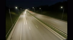 The lights of the cars coming down the highway at night. Time laps - stock footage