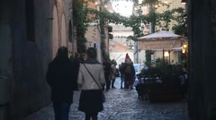 Rome Italy, modest cozy cafe on narrow street evening. Night life Trastevere - stock footage