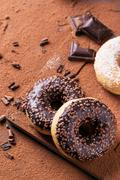 Donuts with cocoa powder and chocolate Stock Photos