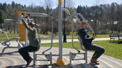 People exercising in an outdoor gym Stock Footage