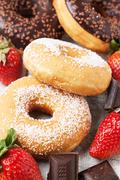 Chocolate donuts with fresh strawberries Stock Photos