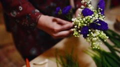 Florist at work: Woman Start Making Modern Bouquet of Spring Flowers. Stock Footage