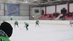 Active men playing hockey on ice rink, masculine hobby, sportive lifestyle Stock Footage