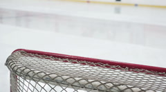 Close-up of hockey net, ice resurfacer driving rink to make surface smooth Stock Footage
