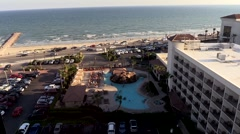 Hotel pool and cars near beach in Texas Stock Footage