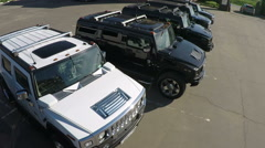 Hummer vehicles on parking lot, aerial view Stock Footage