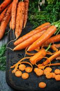 Whole and sliced carrots Stock Photos