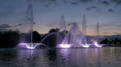 Bright fountain on the water pond or river Stock Footage