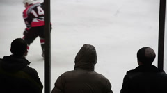 Nervous male fans watching tense ice hockey match, supporting national team Arkistovideo