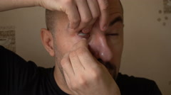 Mature Man Takes Contact Lenses - stock footage
