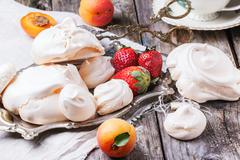 Meringue with apricot and strawberry Stock Photos