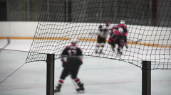 Hockey players skating on rink with sticks, warming up before important match Stock Footage