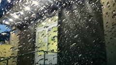 Night City Through Raindrops on a Car Glass Stock Footage