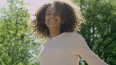 Blissful woman enjoying freedom and life in park. Stock Footage