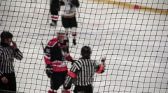 Referee enforcing penalty shot, punishing team for rules violation during match Stock Footage