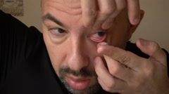 Mature Man Inserts Himself Contact Lenses - stock footage