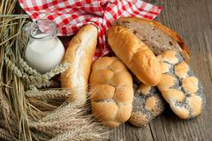 Lot of bread with milk and spikes Stock Photos