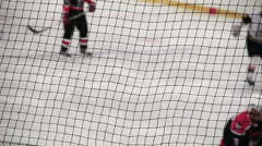 Hockey player shots puck in rival's net, team taking positions before attack Stock Footage