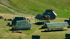 Hikers come in ethno village on the mountain. Stock Footage