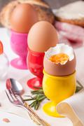 Boiled eggs, rosemary and silverware Stock Photos
