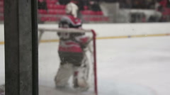 Hockey goalkeeper training on rink, skating in goal crease, waiting for attack Stock Footage
