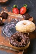 Donuts with fresh strawberries and chocolate Stock Photos
