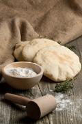 Pita bread with flour Stock Photos