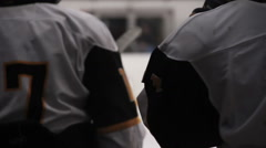 Back view of hockey team players preparing to enter ice rink, winter sport Stock Footage