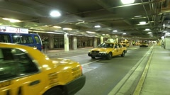 Passanger drop off zone with taxi cabs at Miami Airport Stock Footage