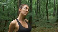 Active weekend. Young attractive brunetka with long hair, doing exercises to Stock Footage