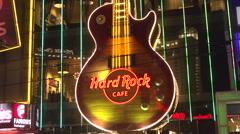 4K: Neon Guitar Plays at Hard Rock Cafe - Las Vega Strip Stock Footage