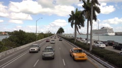 A yellow taxi cab on the way to Miami Stock Footage