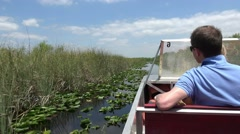Thrilling Airboat Ride through the Everglades Stock Footage