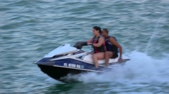 People having fun with a thrilling Jetski ride - stock footage