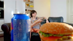Young man refuses to eat junk food Stock Footage