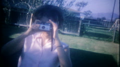 Woman takes photos with her Kodak camera - 3321 vintage film home movie Stock Footage