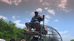 Airboat pilot riding through the Everglades Stock Footage